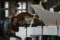 "Anthony Pateras performing on a prepared piano in the Junee Railway Roundhouse workshop  &copy; Bestimmte Rechte vorbehalten von <a href=""http://www.flickr.com/photos/infetel/"">bureau.infetel </a>"